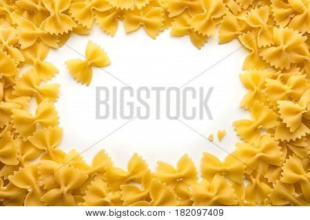 Frame of Farfalle noodles at white isolated background