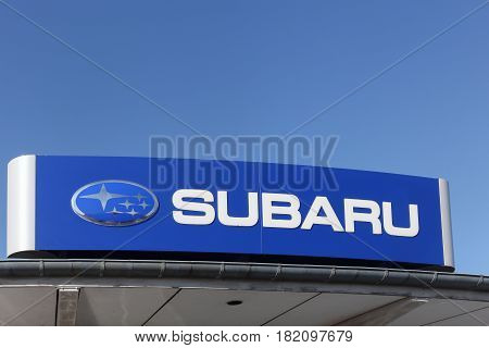 Odense, Denmark - April 9, 2017: Subaru logo on a facade. Subaru is the automobile manufacturing division of Japanese transportation conglomerate Subaru Corporation