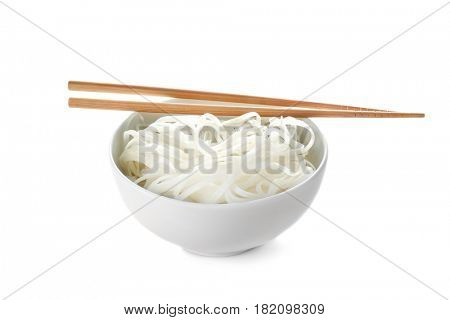 Bowl with rice noodles on white background