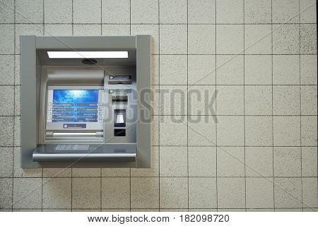 ATM machine. Automated teller bank cash machine on concrete wall. 3d illustration