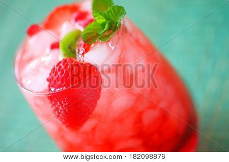 Closeup of wine drink with crushed ice fresh strawberries kiwifruit and mint with copy space
