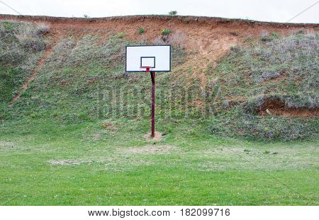 Basketball Field Covered With Grass