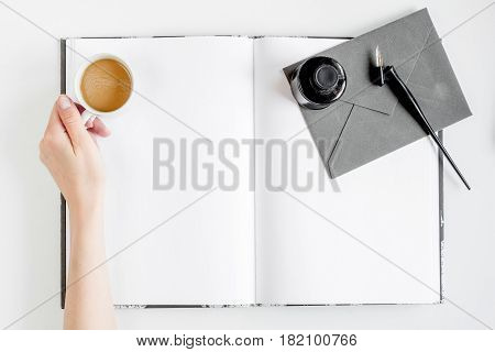 author office with hands in professional writer concept on white work desk background top view mock up