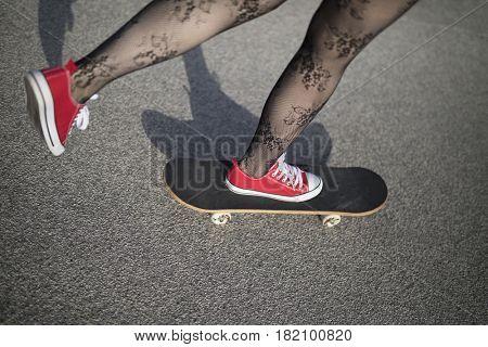Detail of a skater girl skateboarding