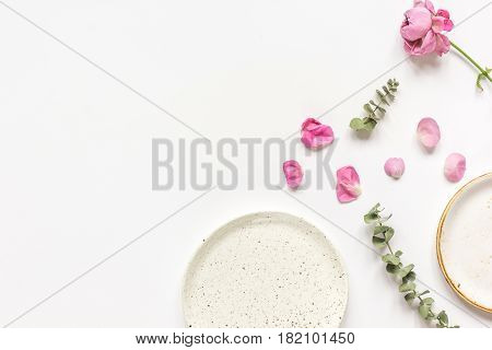 woman table design with rose flower petals top view on white background space for text