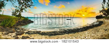 White sandy beach at sunset. Mauritius. Panorama