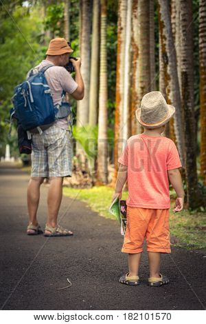 Father and son at botanical garden. Mauritius