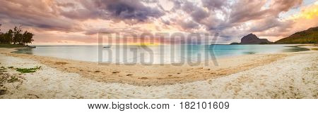 Sandy tropical beach at sunset. Panorama. Mauritius
