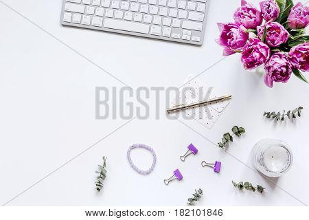 Woman office desk with spring flowers trend on white background top view mockup