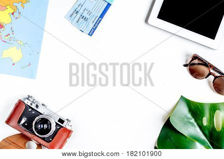 tourist lifestyle with camera, tablet and map on white table background top view mockup