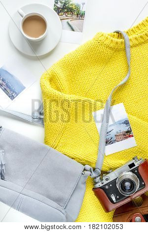 vacation concept with traveller outfit photo camera and tickets on clothes background top view