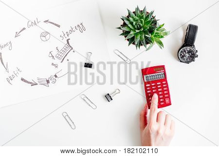 workplace in office with business plan development on white desk background top view