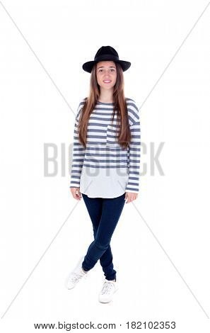 Full portrait teenager girl with a black hat and striped t-shirt isolated on a white background
