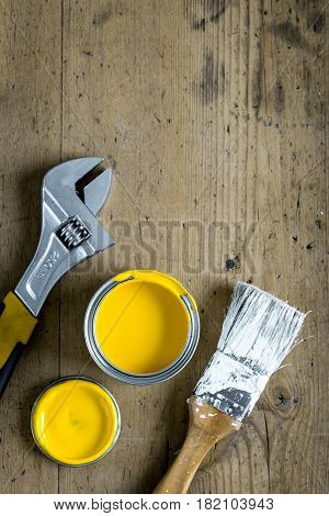 building implements set for house repair on wooden desk background top view space for text