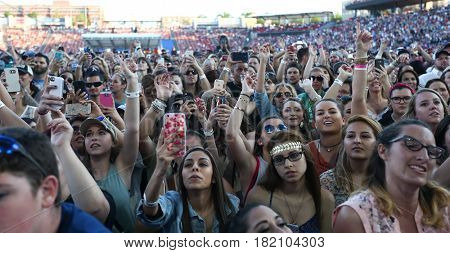 FRISCO, TX-APR 24: Fans cheer for Sam Hunt during the 2016 Off The Rails Music Festival - Day 2 on April 24, 2016 at Toyota Stadium in Frisco, Texas.