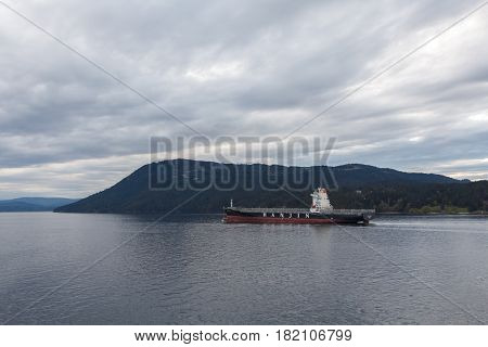 Victoria, Canada - Circa 2017: Cargo ship sailing through British Columbia waterways