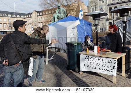 HELSINKI, FINLAND - APRIL 8, 2017: People at the agitation tent on the day before the elections. The councils in 297 municipalities in Finland is elected on April 9
