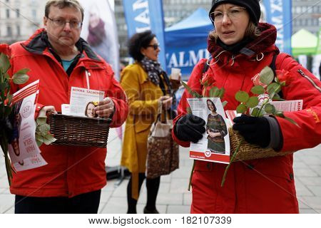 HELSINKI, FINLAND - APRIL 8, 2017: Agitation on the street in the day before the elections. The councils in 297 municipalities in Finland is elected on April 9