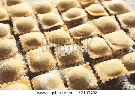 Uncooked ravioli on table, closeup