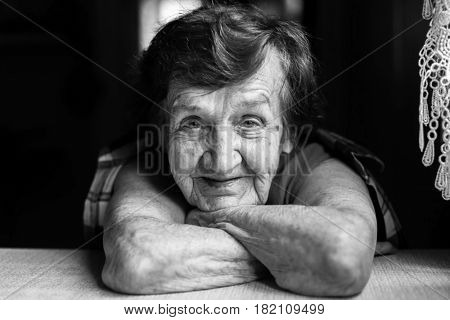 Portrait close-up of a happy elderly woman. Black and white photo.