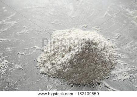 Heap of flour on table