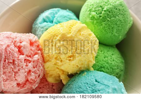 Bowl with different tasty ice cream, closeup