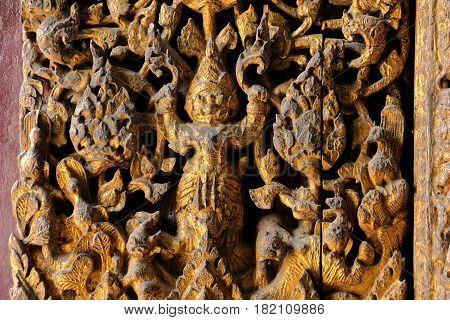 ancient wood craft of Garuda at the door of temple