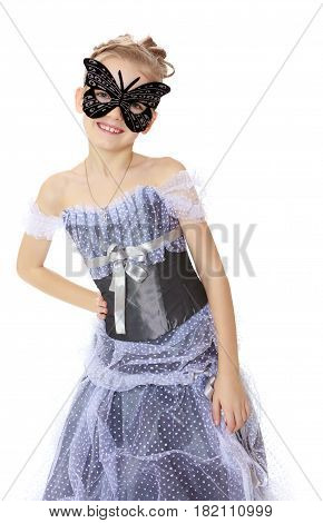 Slender little girl , with beautiful hair on his head, elegant long Princess dress.Posing in carnival mask.Isolated on white background.