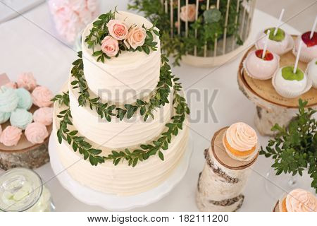 Cake and tasty sweets on table prepared for party
