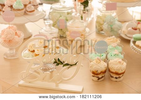 Wooden decor on table with sweets prepared for party