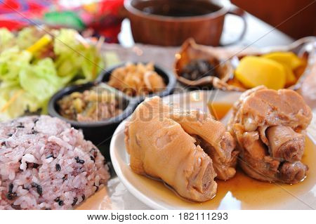 Meal Of Rice In Chinese Style With Pig's Legs