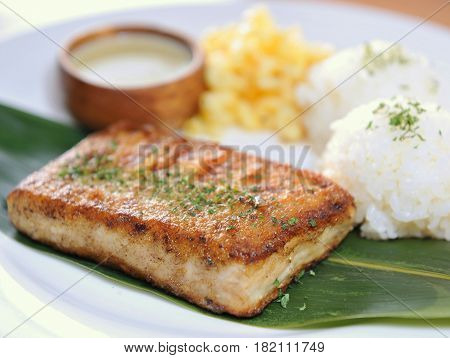 Platter Of Rice With Fried Fish Fillet