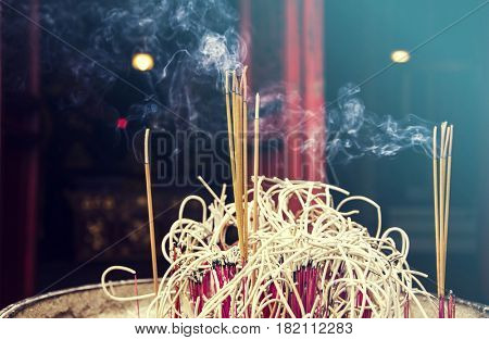 Burning incense stick in a chinese temple in Hanoi, Vietnam