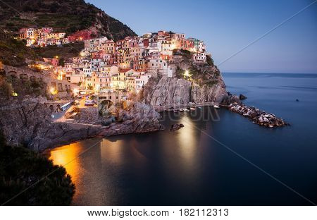 scenic night view of colorful village Manarola, Cinque Terre, Italy