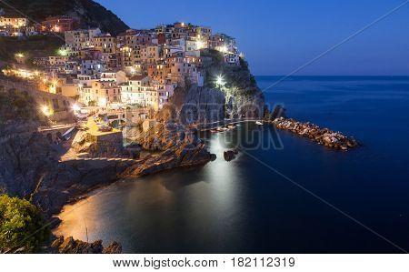 scenic night view of colorful village Manarola, Cinque Terre, Italy