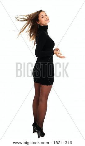 Woman In Black Dress And Stockings Turn Around With Her Hair Waving