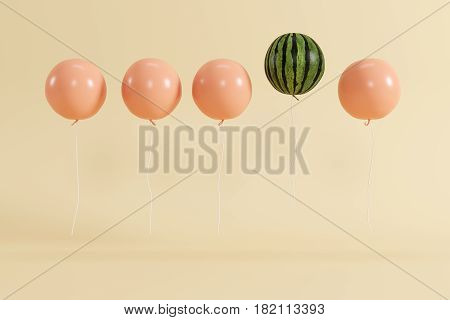 Outstanding balloon watermelon in air concept on pastel yellow background for copyspace. minimal concept.