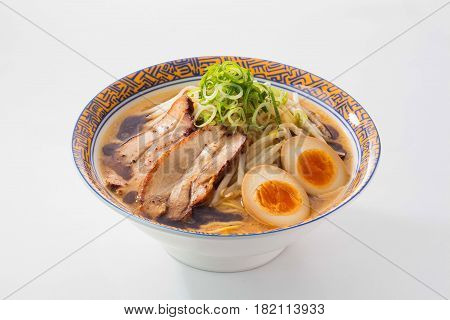Ramen noodle with pork and eggs on white