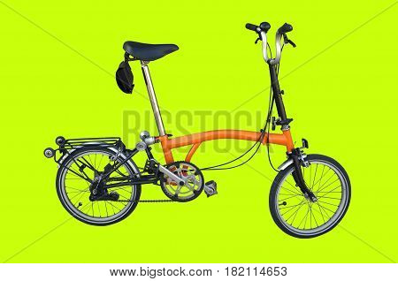 Orange bicycle parks on green background  , Concept travel bicycle