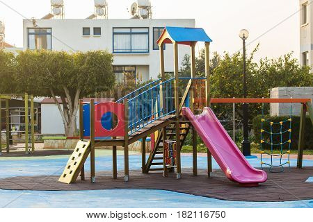 Children swing in the park at Playground. Children's playground outdoor