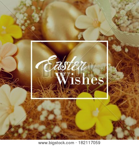 Easter greeting against golden easter eggs with flowers in nest