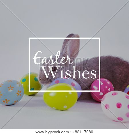 Easter greeting against colorful easter eggs and easter bunny
