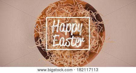 happy easter against golden easter eggs in bowl