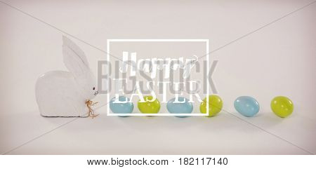 Easter greeting against easter eggs in row with toy easter bunny