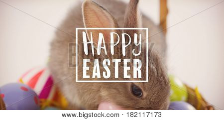 Easter greeting against bunny on easter eggs in basket