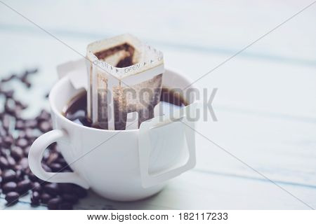 Instant freshly brewed cup of coffee drip bag fresh coffee