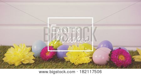 Easter greeting against multicolored easter egg on grass
