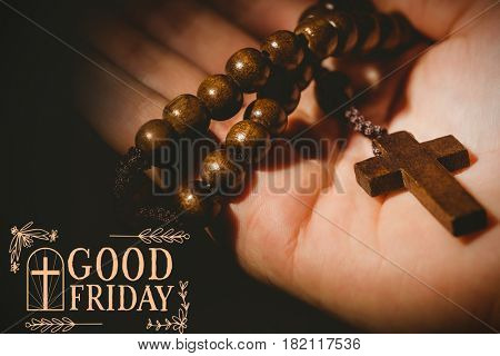 Easter message against hand holding rosary beads