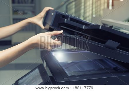 woman opening a copying device, close up