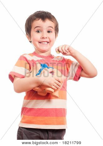 Litle Boy Puts The Coin Into The Piggy Bank
